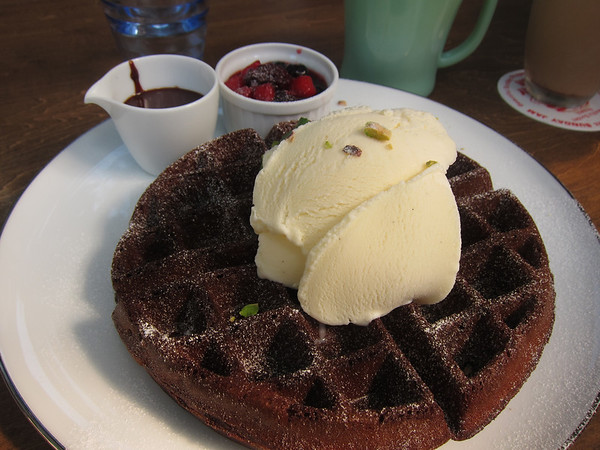 Spectacular chocolate waffle topped with gelato, fresh berry compote, and chocolate sauce.