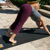Kaylie Finnis practices yoga on the #kindawesome yoga mat from KIND Healthy Snacks.