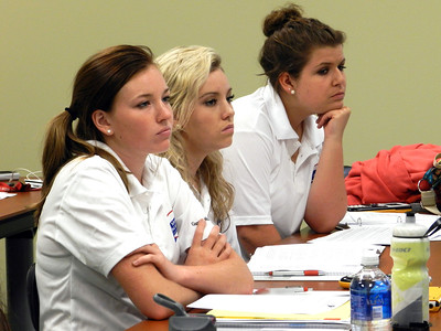 Math Academy students listen in during a classroom session.