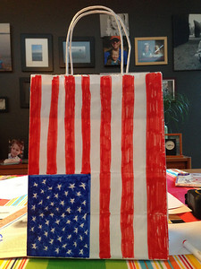 Decorating our 4th of July parade candy collection sacks the night before!