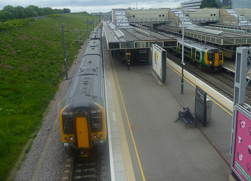 Crewe services cross at MK! Desiro 350112 with the 12:19 to Crewe and 350116 with the delayed 12:14 to Euston, 13/06/2013.