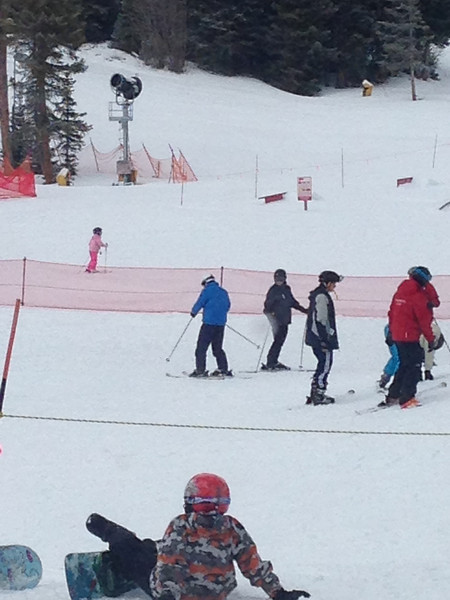 Learning to ski.  Just look for Lindsay in the bright blue jacket and Elijah in all black.
