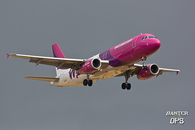 Airbus A.320 HA-LWK of Wizz Air just before a rain storm.