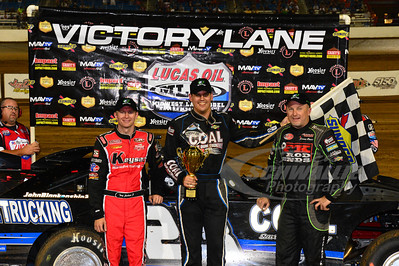 Tony Jackson, Jr. (left) and Jimmy Owens (right) in Victory Lane with race winner John Blankenship