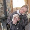 RITA ADMIRES ONE OF GLENN'S PUPPIES...DIDN'T TAKE ONE HOME THO...