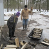 RITA TRIES HER HAND AT WOOD-SPLITTING...NOTICE HOW FAR AWAY BOTH DARREL & MYSELF ARE STAYING?