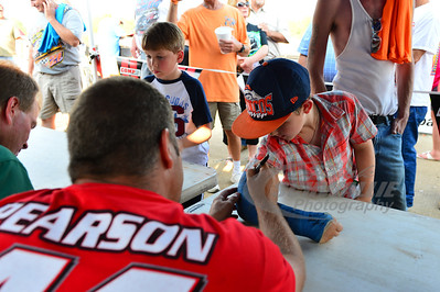 Earl Pearson, Jr. signs an autograph