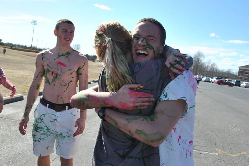 Students participate in a paint fight during the End It Movement human trafficking awareness week.