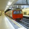 A train of London Underground Circle Line C-stock leaving Blackfriars.