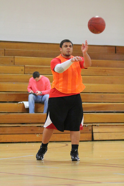 Michael Rozmus plays for his Intramural Basketball game Friday night in Bost Gym.