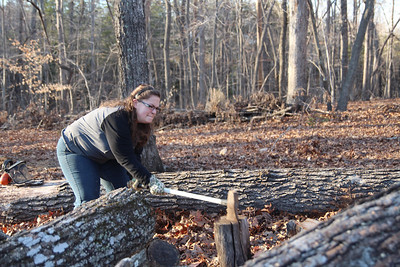 Stephanie McKellop chops through a block of wood for the first time.