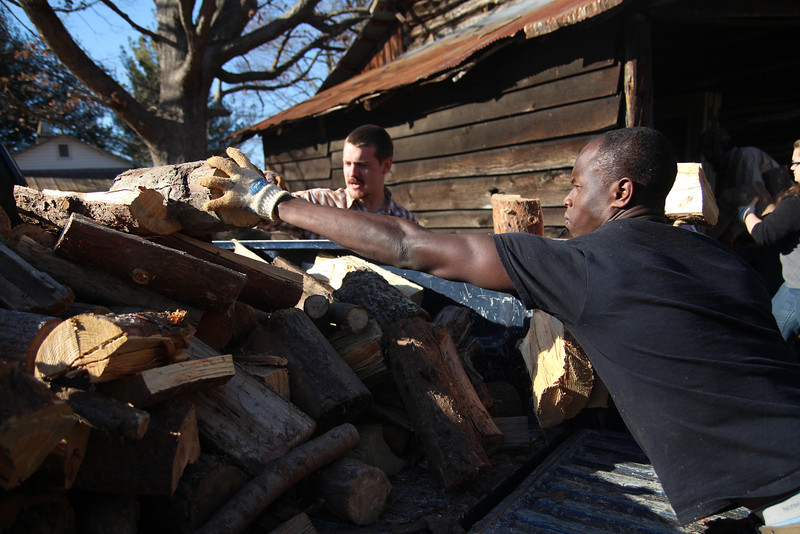 Gardner-Webb students, Devan Vanderbark and Darelle Dove, help pitch in to give chopped wood to the communities.