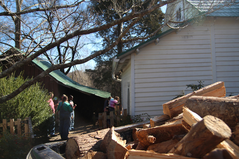 With a whole team of students, filling up a truck full of chopped wood went easy for this family.