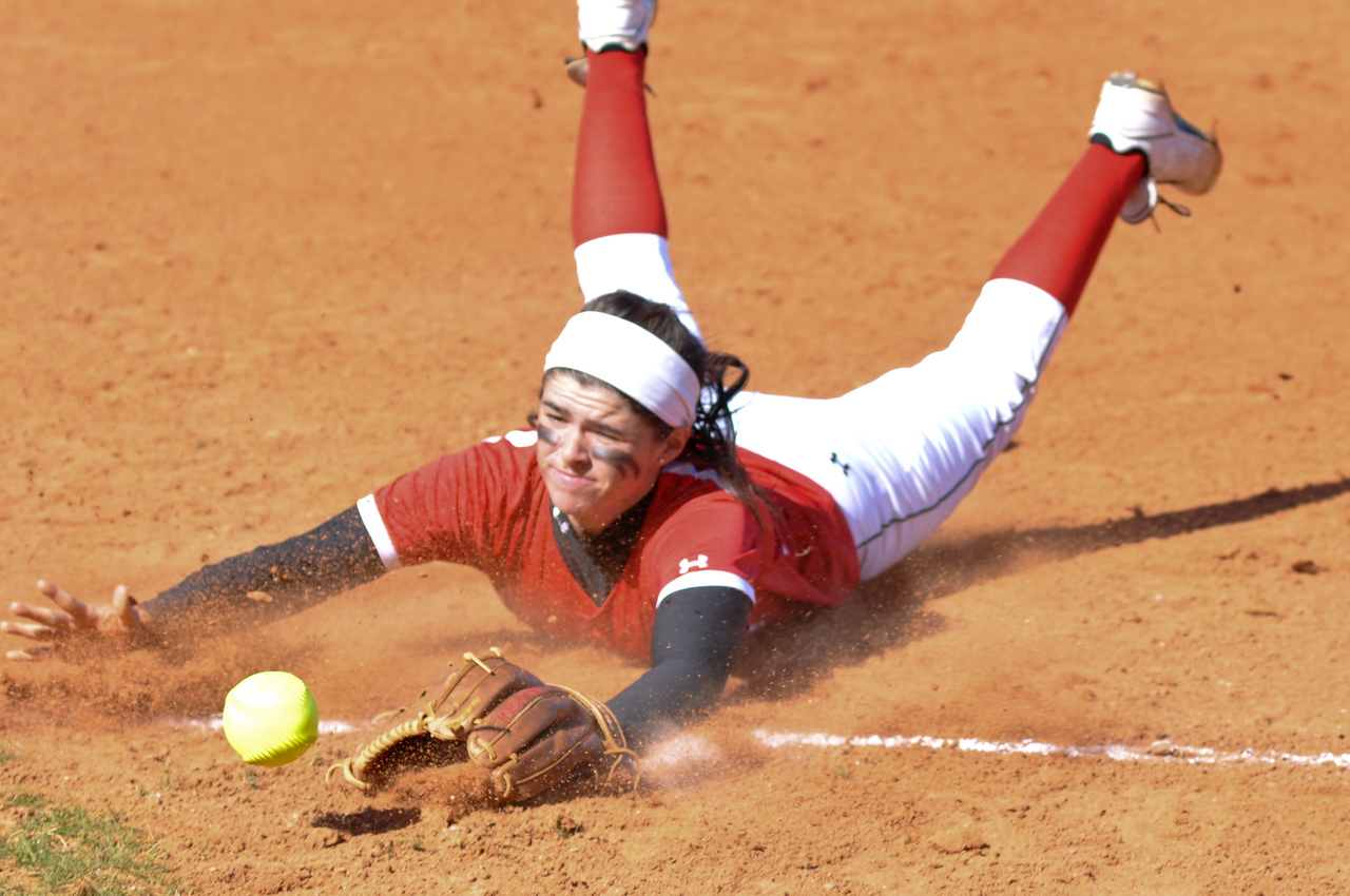 Savannah Burns dives after a hit from USC Upstate Thursday March 7, 2013.