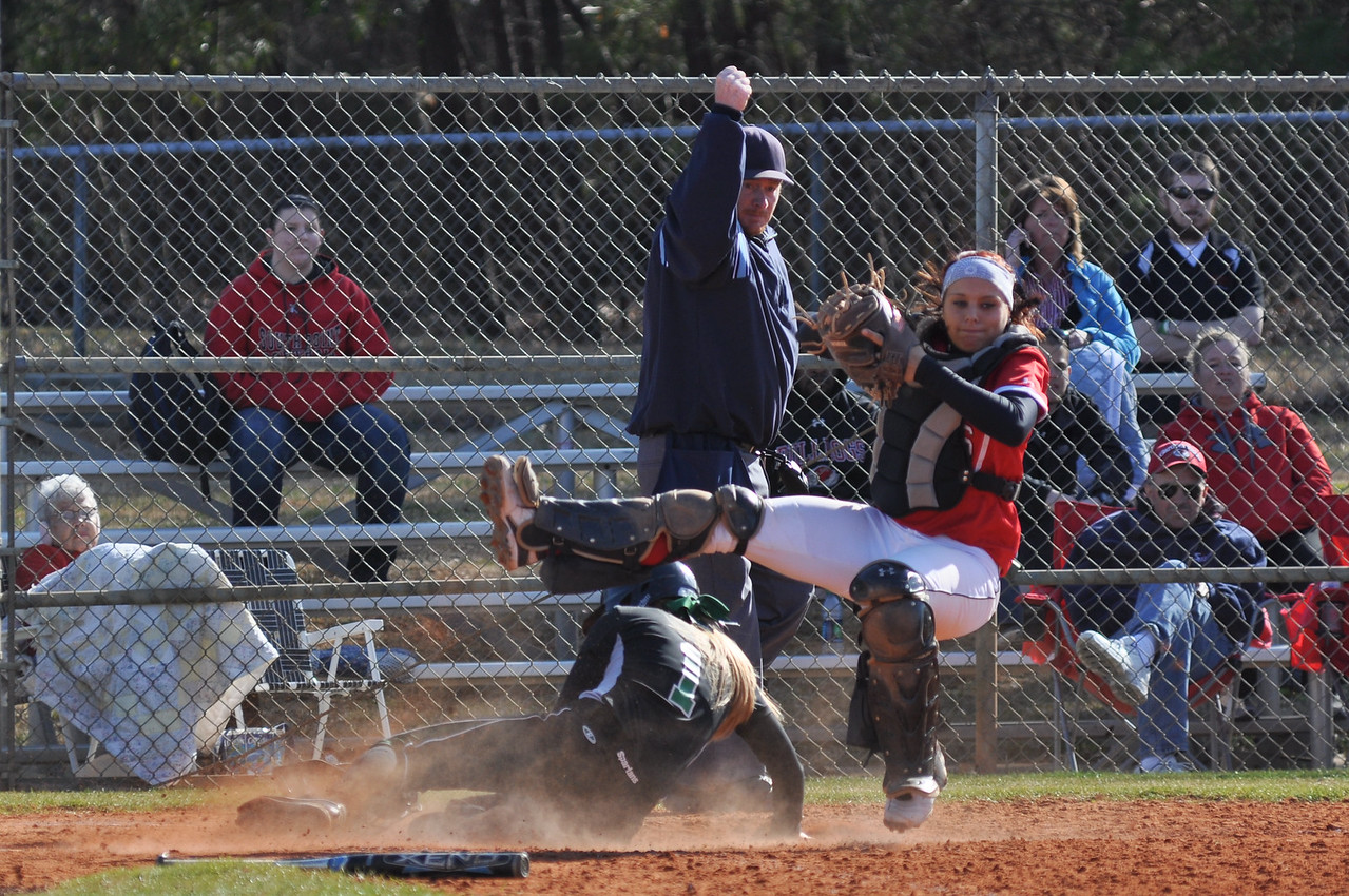 Taylar Pridgen gets knocked off her feet by a USC Upstate player Thursday March 7, 2013.