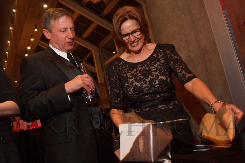 David and JoAnn Lang opening a surprise box.  Saturday Night Alive, benefiting the Denver Center Theatre Company and its Education Department, at the Denver Center for Performing Arts, Seawell Ballroom, in Denver, Colorado, on Saturday, March 2, 2013.<br /> Photo Steve Peterson
