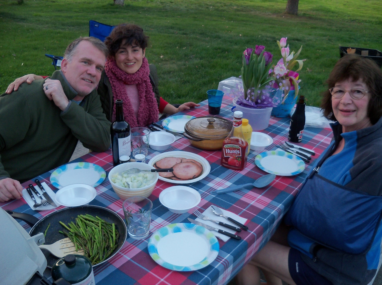Easter Dinner in the park. glazed ham, au gratin potatoes, garlic butter asparugs, cucumber salad and chocolate easter eggs!