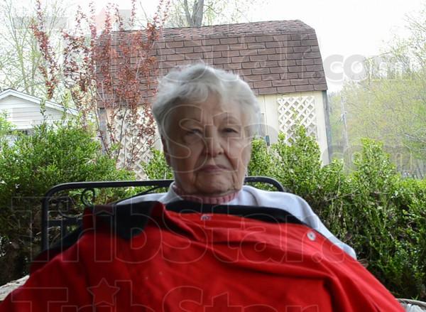 Thelma Niehaus on porch