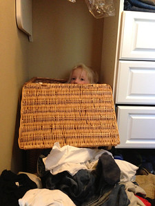 BUSTED. Found playing iPhone in Peter's hamper