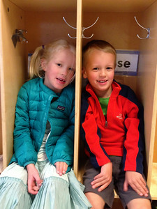 Amelia and Connor sitting inside the kindergarten cubbies at the EEU. Related perhaps?
