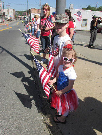 Irelynd Bara, 4 watches the parade with brother Aiden, 10, and Nathan Spencer, 10