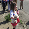 Naomi Savage, 7, watches the parade