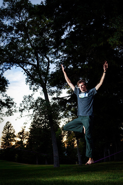 Slacklining fun set up in a park in Bozeman.
