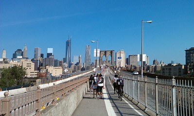 The pedestrian/bike path across the Brooklyn Bridge.  In the background is the Manhattan skyline; notably, the new One World Trade Center (Freedom Tower)