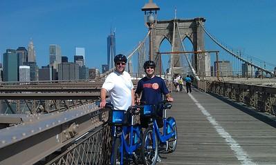 After running from Brooklyn to Manhattan across the Brooklyn Bridge, DJ (l) and Craig bike back using Citi Bikes.