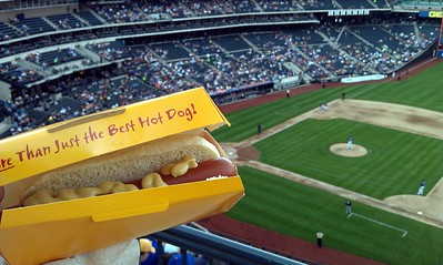Enjoying a veggie dog and our national pastime.