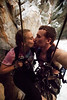Pausing for a kiss while free-hanging in a cave on a simul-rappel!