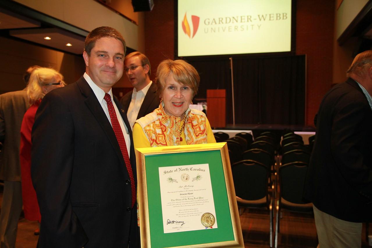 Senator Warren Daniel stands by Brownie as she holds her award.