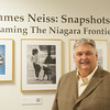 131119 Neiss VIERA/STAFF PHOTOGRAPHER Niagara Falls, NY-Niagara Gazette photo chief James Neiss stands in front of his work at the opening of Snapshots: Roaming the Niagara Frontier at the Niagara Falls Conference Center on Tuesday Nov 19th, 2013.