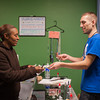131120 Ecigs VIERA/STAFF PHOTOGRAPHER Lockport, NY- Sharon Riddick purchases juice for her electronic cigarette from Nick Brostko at his store Pleasant Puffs on Wednesday Nov 20th, 2013. Riddick has successfully used electronic cigarettes to quit tobbaco products.