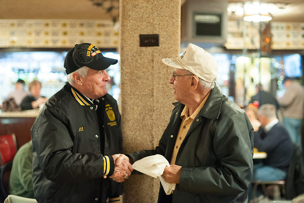 131111 American Legion JOED VIERA/STAFF PHOTOGRAPHER Lockport, NY- American Legion Vice Commander Bill Burnett shakes WW2 Veteran Everett Fitchlee's handg after handing him a U.S. Army Air Force scarf at the American Legion after the Veterans Day event in Outwater Park on Monday Nov 11th, 2013.