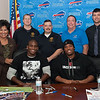 131112 Bills Signing VIERA/STAFF PHOTOGRAPHER Lockport, NY-back row: United Way President Carol Houwaart-Diez, NCDSA Vice-President Rick Werth, NCDSA President Jeff newman, Bill Jakobi, and Michael Oliver. Sitting: Buffalo Bills Safety Aaron Williams and running back Fred Jackson at the Niagara County Deputy Sheriffs Association Corrections and Dispatcher's union office during an autograph event on Tuesday Nov 12th, 2013.