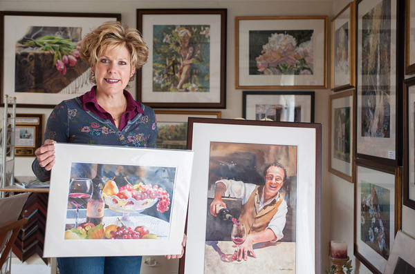 131119 Art/Trails Gills VIERA/STAFF PHOTOGRAPHER Gasport, NY- Watercolorist Kathleen Giles stands with her artwork in her studio on Tuesday Nov 19th, 2013.