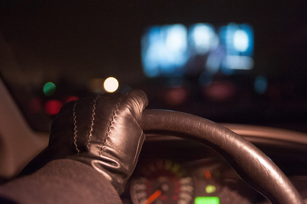 "131121 Hunger Games JOED VIERA/STAFF PHOTOGRAPHER Lockport, NY- US&J photographer Joed Viera watches ""The Hunger Games"" from inside of his car at the Transit Drive-In Theater on Thursday Nov 21st, 2013."