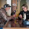 131114 3A Ent VIERA/STAFF PHOTOGRAPHER Wilson, NY-Shamus Lampman a regular at the Wilson House Restaurant and Inn is handed a beer by bartender and server Valerie Lavery on Thursday Nov 14th, 2013.