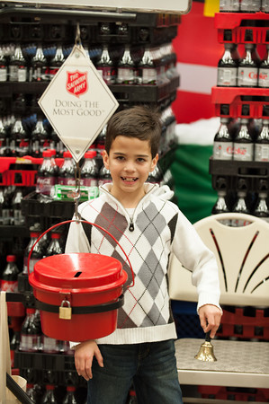 131121 Bell Ringer JOED VIERA/STAFF PHOTOGRAPHER Lockport, NY-Sam Sattler rings the Salvation Army's bell asking for donations at Tops on Thursday Nov 21st, 2013.