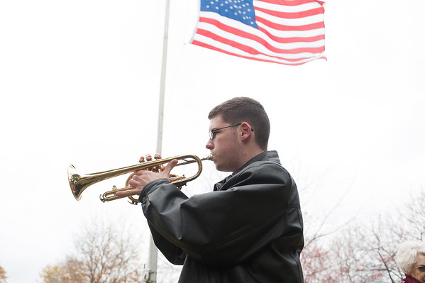 131111 VT Day JOED VIERA/STAFF PHOTOGRAPHER Lockport, NY- James quinones plays Taps on trumpet at the Veterans Day event in Outwater Park on Monday Nov 11th, 2013.