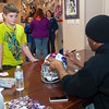 131112 Bills Signing VIERA/STAFF PHOTOGRAPHER Lockport, NY-Buffalo Bills running back Fred Jackson autographs a helmet for Dillan Reabold (11) at the Niagara County Deputy Sheriffs Association Corrections and Dispatcher's union office on Tuesday Nov 12th, 2013.