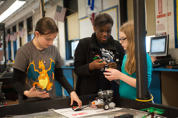 131112 Lego Robots VIERA/STAFF PHOTOGRAPHER Lockport, NY-Team Jolt's Michaellean Brown (11),   Faith Obot (11),and Katie miner (11) work on their robot Jolt Lightning on Tuesday Nov 12th, 2013.