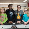131112 Lego Robots VIERA/STAFF PHOTOGRAPHER Lockport, NY-Team Jolt Katie Strobel (11), Faith Obot (11), Michaellean Brown (11),and Katie Miner (11) stand behind their robot Jolt Lightning on Tuesday Nov 12th, 2013.
