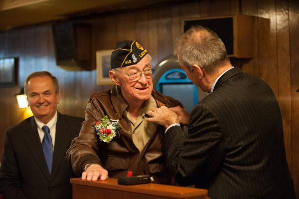 131121 WW2 MOH JOED VIERA/STAFF PHOTOGRAPHER Lockport, NY-Buffalo French Consulat Pascal Soarès pins the award on Ed Kolek at the American Legion Post on Thursday Nov 21st, 2013.