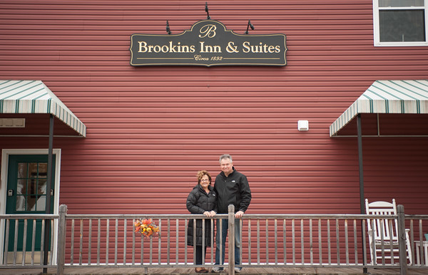 131107 Brookins Inn JOED VIERA/STAFF PHOTOGRAPHER Newfane, NY- Brookins Inn & Suites owner Beverly and Dan Mandaville stand in front of their establishment on Thursday Nov 7th, 2013.