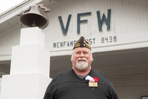 131107 Vet Poppy JOED VIERA/STAFF PHOTOGRAPHER Newfane, NY-Retired  U.S. Army Sgt Larry Bowman stands in front of Newfane's VFW post on Thursday Nov 7th, 2013.