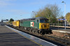 22 November 2013 :: 56303 was moving the Railvac from Totton to Doncaster today and is seen passing through Basingstoke hauled by DCR's 56303.  The train is 6Z41