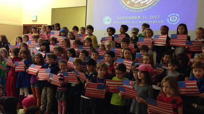 1st graders singing Grand Old Flag.
