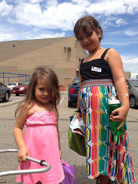 Sophie and Keirah say farwell at the Boulder YMCA where they often played together during Jessica's exercise classes.